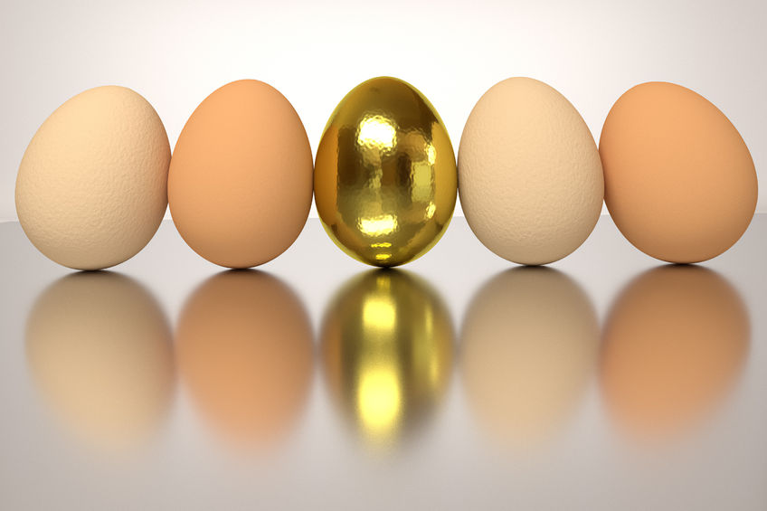 53585980 - row of the rendered eggs on a shiny table